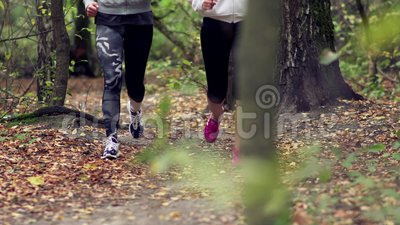 2 woman run in the forest stock video footage