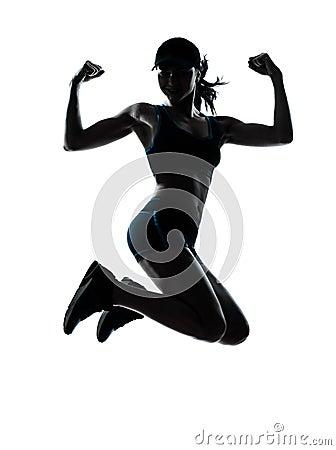 Woman runner jogger jumping powerful