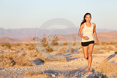 Woman runner running cross country trail run