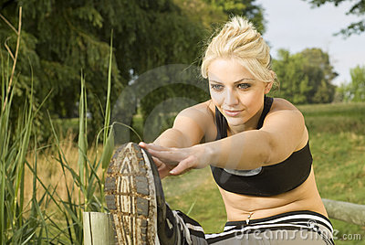 Woman runner stretching hands forward