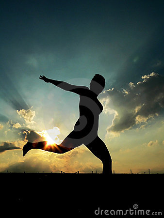 Woman Running, against sunset