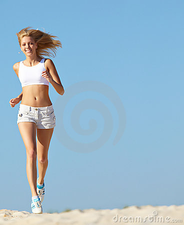 Woman running on beach