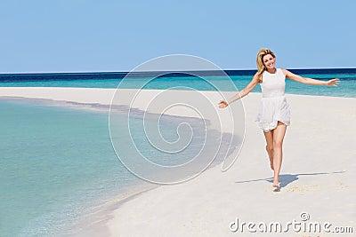 Woman Running On Beautiful Tropical Beach