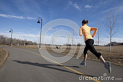 Woman running on city path