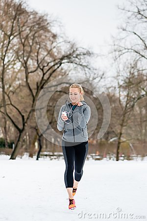Free Woman Running Down A Path On Winter Day In Park Royalty Free Stock Photography - 108308087