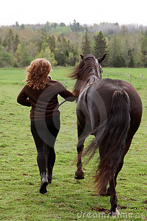 Woman running with horse