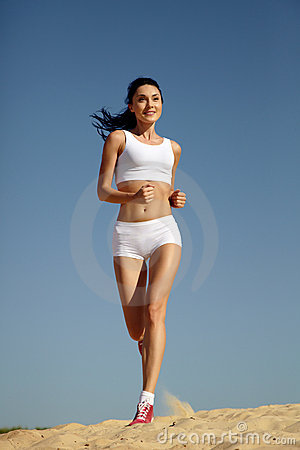 Woman running on sand