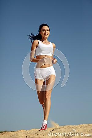 Woman running on sand