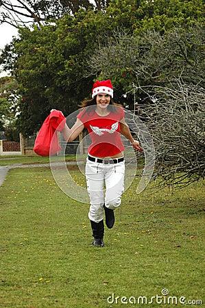 Woman running in Santa hat