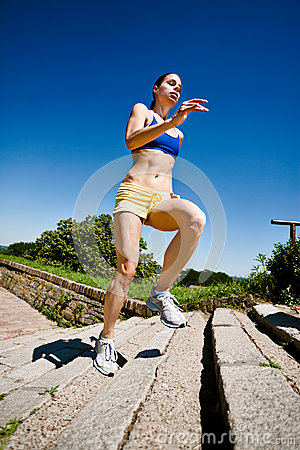 Woman running upstairs