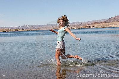 Woman running in water