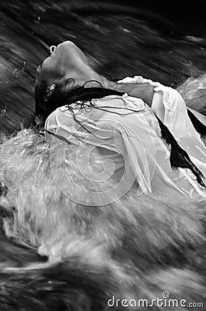 woman in rushing water