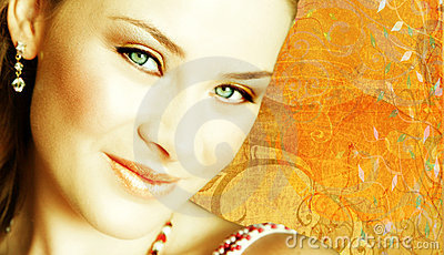 Woman s face close-up on grunge background