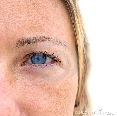 Woman s face with colorful blue eyes.