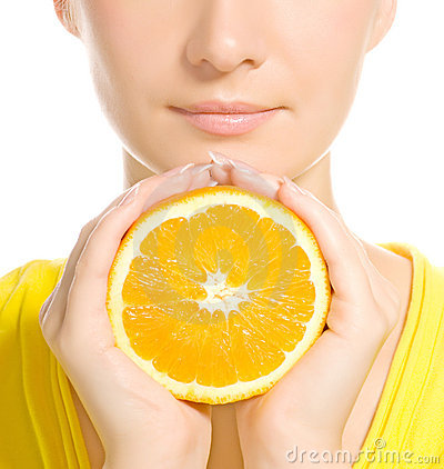 Woman s face with juicy orange