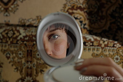 Woman s face in the mirror