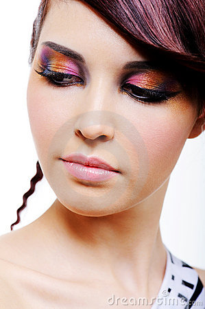 Woman s face with multicoloured eyeshadow