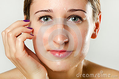 Woman s face with water drops