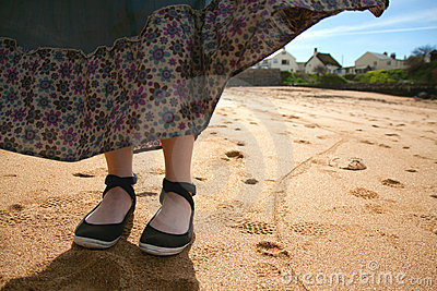 Woman s feet on a beach