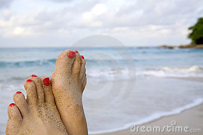 Woman s feet on the beach