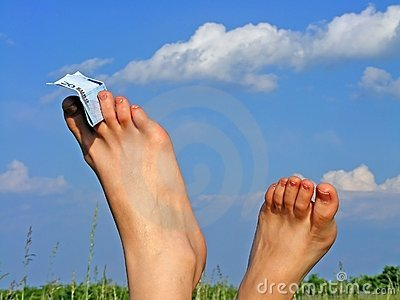 Woman s feet and blue sky
