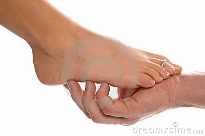 Woman s foot and mans hand