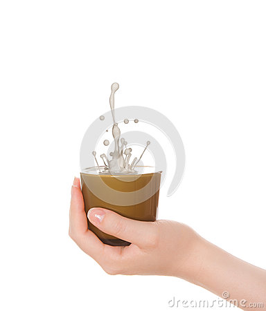 Woman s hand a cup with splash