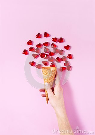 Free Woman`s Hand Holding A Scoop Of Ice-cream. Heart Shape Drops All Around Imitating Ice-cream. Stock Image - 107331331