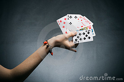 Woman s hand holding playing cards
