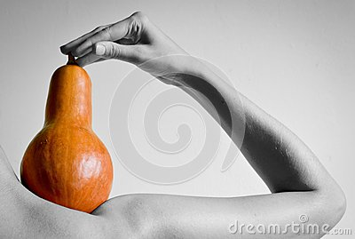 A woman s hand holds pumpkin