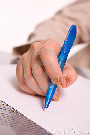 Woman s hand with pen signing a paper