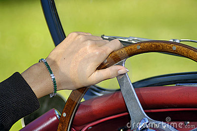 Woman s hand on the steering wheel