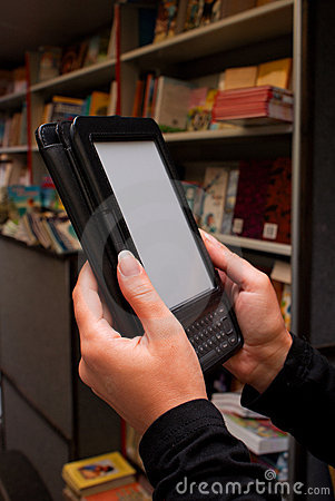 Woman s hands with electronic book reader
