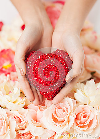 Woman s hands holding heart
