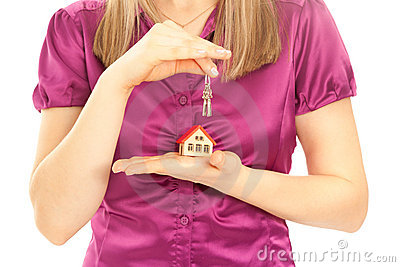 Woman s hands holding house and keys