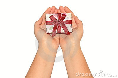 Woman s hands holding present box with red ribbon