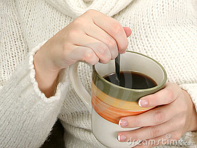 Woman s Hands with Mug of Coffee and Spoon