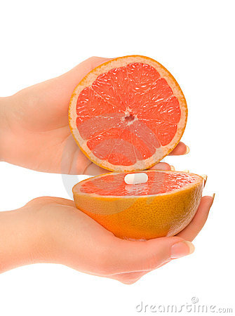 Free Woman S Hands With Two Pieces Of Grapefruit Stock Photography - 12687152
