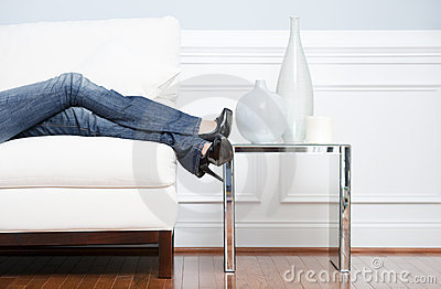 Woman s Leg s Reclining on White Couch
