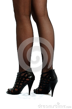 Woman s legs brown hold-ups stockings