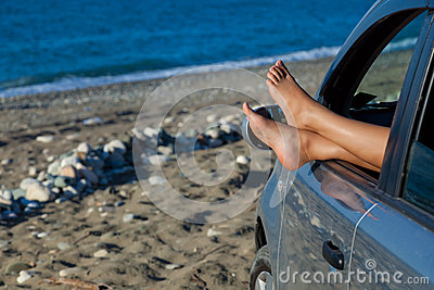 Woman s legs dangling out a car window