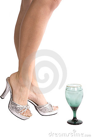 Woman s legs with glass
