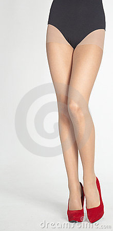 Woman s Legs in Nude Hose Against White Backgroun