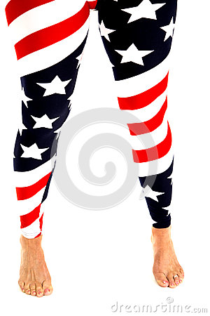 Woman s legs in stars and stripes leggings bare feet