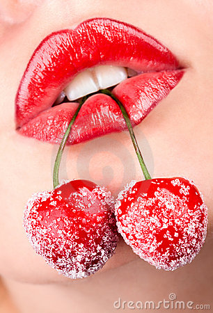 Woman s mouth with red cherries