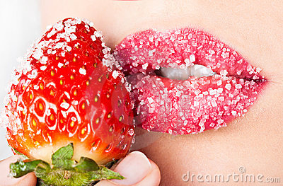 Woman s mouth with red strawberry
