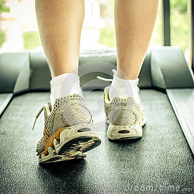 Free Woman S Muscular Legs On Treadmill Stock Photography - 44184052