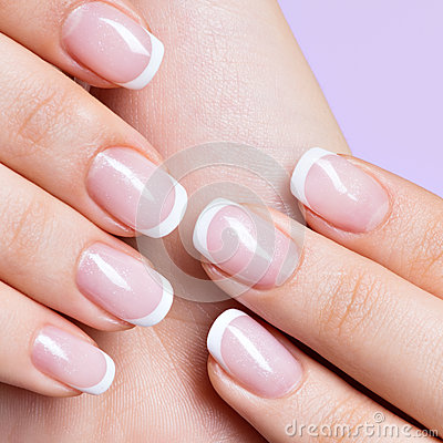 woman 39 s nails with beautiful french white manicure stock. Black Bedroom Furniture Sets. Home Design Ideas