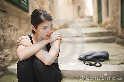 Woman with sad face crying.Sad expression,sad emotion,despair,sadness.Woman in emotional stress and pain.Woman sitting alone on th Stock Photo