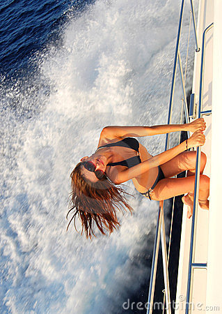 Woman sailing on private speed-boat yacht